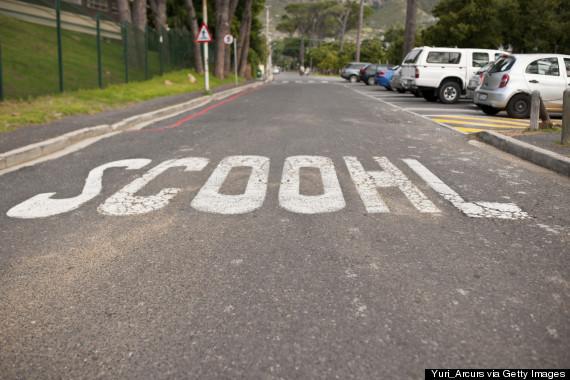misspelled school crossing sign